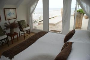 Duplex Suite met Patio en Uitzicht op de Oceaan - Pebbles