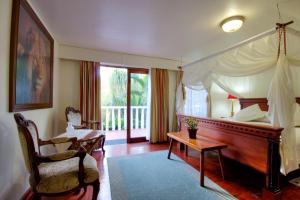 Deluxe Zimmer mit Kingsize-Bett und privatem Eingang