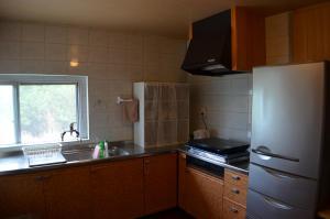 Guest House Isa, Гостевые дома  Мотобу - big - 42