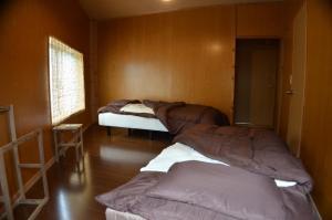 Guest House Isa, Гостевые дома  Мотобу - big - 4