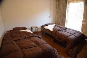 Guest House Isa, Гостевые дома  Мотобу - big - 3