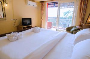 Anda Orange Pier Guesthouse, Penziony  Chalong  - big - 5