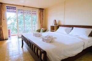 Anda Orange Pier Guesthouse, Penziony  Chalong  - big - 12