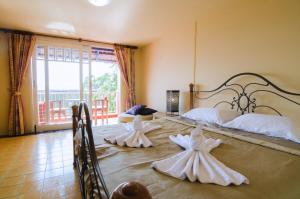 Anda Orange Pier Guesthouse, Penziony  Chalong  - big - 22