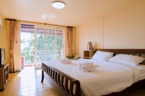 Anda Orange Pier Guesthouse, Penziony  Chalong  - big - 21