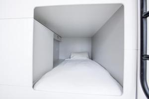 Cápsula en habitación compartida