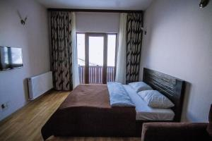 Sweet Home Apartments, Appartamenti  Gudauri - big - 8