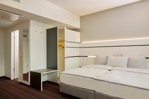 Dvoulůžkový pokoj typu Business s manželskou postelí
