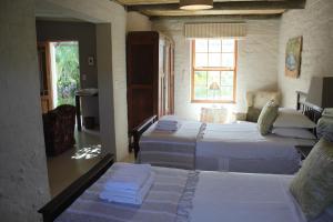 Стандартный двухместный номер с 2 отдельными кроватями и видом на сад