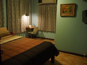 Pokoj Deluxe s postelí Queen