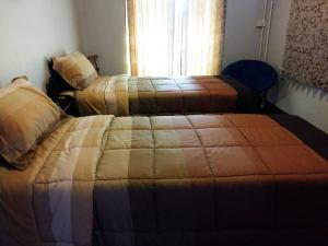 Dvoulůžkový pokoj typu Standard s oddělenými postelemi a společnou koupelnou