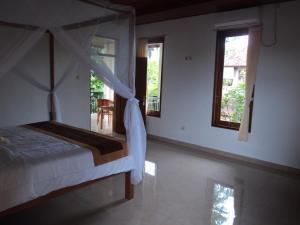 Villa Bhuana Alit, Гостевые дома  Убуд - big - 20