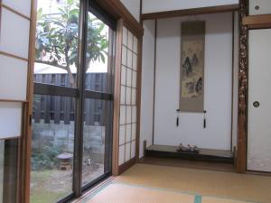 Enman Guest House Osaka, Гостевые дома  Осака - big - 15