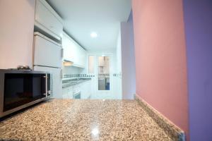 Apartamentos Kasa25 Golf & Beach Hoyo 18, Apartmanok  Alicante - big - 24
