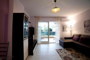 Apartamentos Kasa25 Golf & Beach Hoyo 18, Apartmanok  Alicante - big - 36