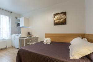 Hotel De L'Horloge, Aparthotels  Paris - big - 49