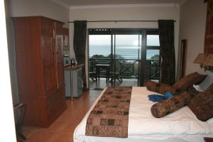 Quarto com Cama King-size e Vista Mar