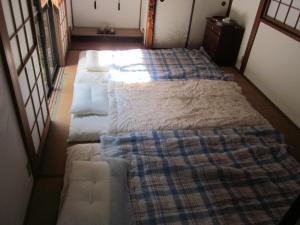 Enman Guest House Osaka, Гостевые дома  Осака - big - 10