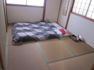Enman Guest House Osaka, Гостевые дома  Осака - big - 9