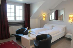 Dvoulůžkový pokoj typu Economy s manželskou postelí nebo oddělenými postelemi