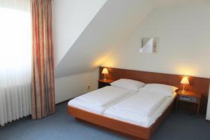 Dvoulůžkový pokoj s manželskou postelí nebo oddělenými postelemi (1 dospělý)