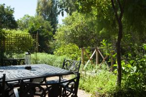 Casa Rústica - Vista Jardim