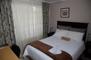 Timosha Guest House, Pensionen  Kempton Park - big - 9