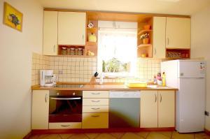 Apartments Tonzi, Ferienwohnungen  Malinska - big - 16