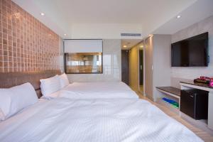 Shui Sha Lian Hotel, Szállodák  Jücsi - big - 14