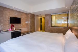 Shui Sha Lian Hotel, Szállodák  Jücsi - big - 19