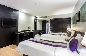 Grand Deluxe Triple Room