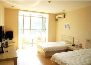 Daily Holiday Business Inn, Отели  Yongqing - big - 13