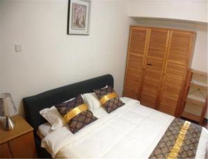 Qingdao Dusco Holiday Apartment Shilaoren Park, Apartmanok  Csingtao - big - 6