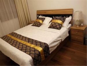 Qingdao Dusco Holiday Apartment Shilaoren Park, Apartmanok  Csingtao - big - 2