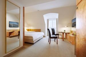 Dvoulůžkový pokoj Economy Class s manželskou postelí