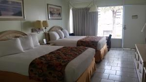 Deluxe Queen Room with Two Queen Beds and Pool View