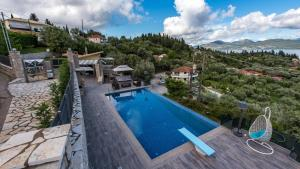 Luxurious Villa Kastro with Salt Water Swimming Pool, Vily  Nikiana - big - 60