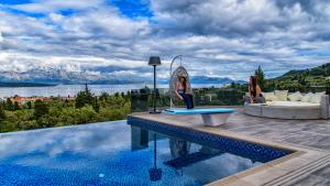 Luxurious Villa Kastro with Salt Water Swimming Pool, Vily  Nikiana - big - 4