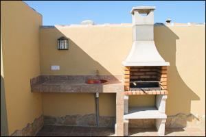 Bungalow Curro Pareja 131, Dovolenkové domy  Conil de la Frontera - big - 4