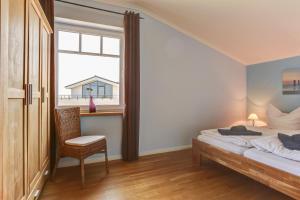 Ferienwohnungen Strandvilla Börgerende, Appartamenti  Börgerende-Rethwisch - big - 48