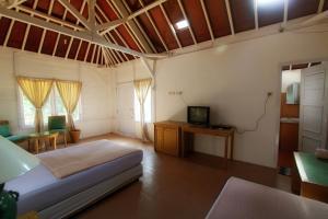 G-Land Joyo's Surf Camp, Гостевые дома  Баньюванги - big - 8