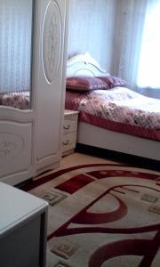 Apartment 16 Mikrorayon 42, Ferienwohnungen  Shymkent - big - 9