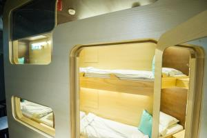 Capsule Room with Shared Bathroom