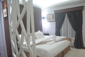 DM Residente Hotel Inns & Villas, Hotely  Angeles - big - 48