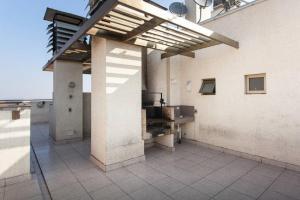 Departamento Edificio Vision, Apartmány  Santiago - big - 4