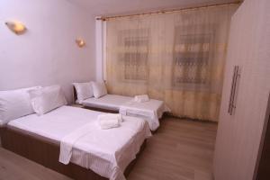 Nirvana Accommodation, Апартаменты  Бухарест - big - 70