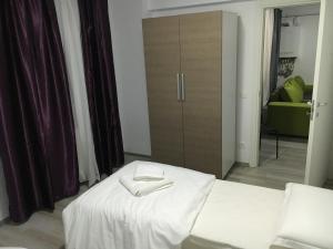 Nirvana Accommodation, Апартаменты  Бухарест - big - 78