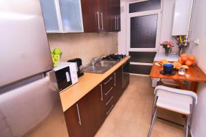 Nirvana Accommodation, Апартаменты  Бухарест - big - 104