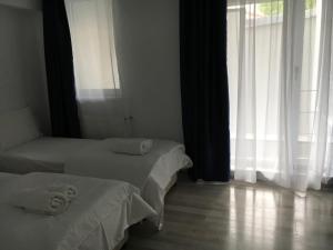 Nirvana Accommodation, Апартаменты  Бухарест - big - 98