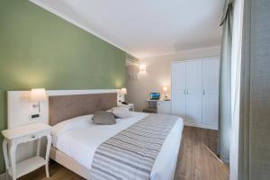 Hotel Garni Corona, Отели  Менаджо - big - 12